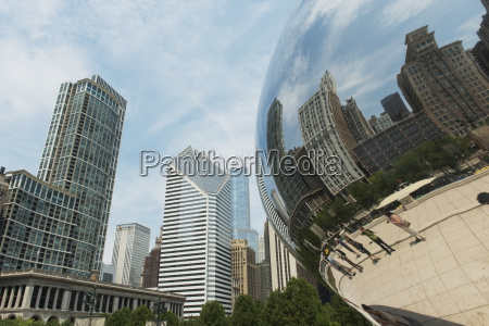 pedestrians and buildings reflected in a