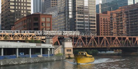a yellow boat in the river