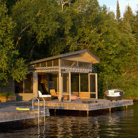 a cottage with wooden dock on