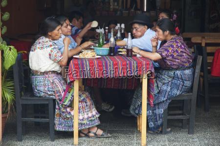 maya family joying lunch at a