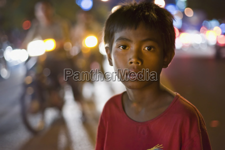 a cambodian begger plys his trade