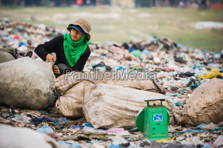 cambodia woman with plastic sacks in