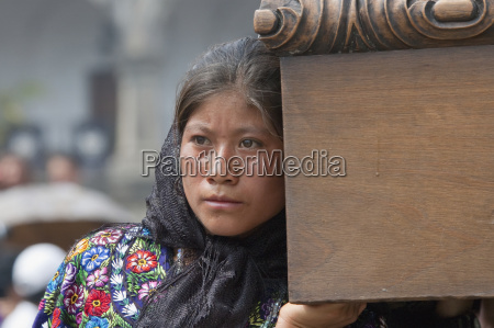 woman dressed in mourning helps carry