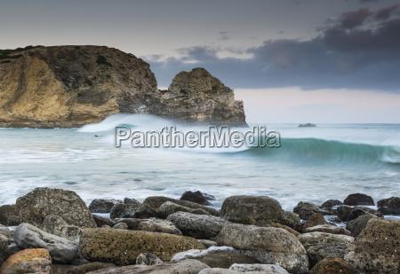 portugal algarve waves crashing into rocks