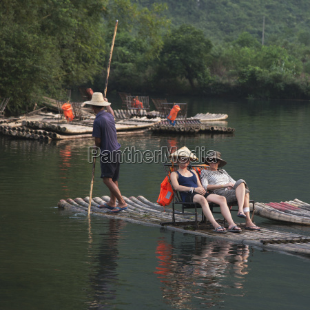 tourists sit on a boat being