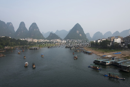 boats in li river with mountain