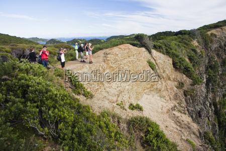 a group of tourists take photographs
