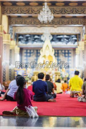 thailand chiang mai buddhist worshippers kneeling
