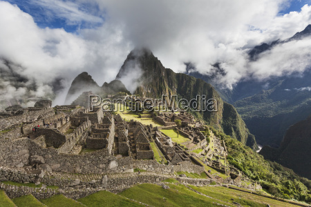 morning fog and clouds reveal machu