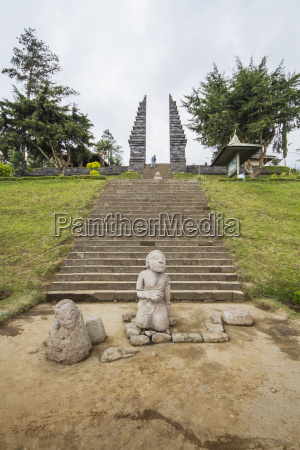 stone statue and ceremonial gate of