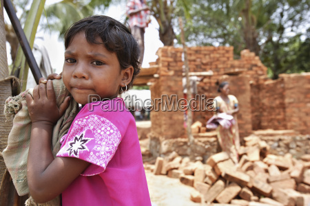 a young girl watching the construction