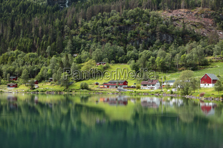 the tranquil water of nordfjorden reflecting