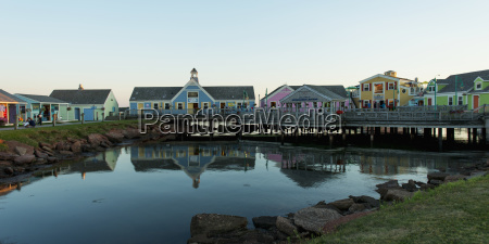 colourful buildings in spinnakers landing reflected