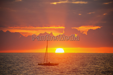 sailboat at sunset off of the