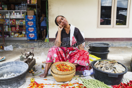 woman selling hot peppers at the