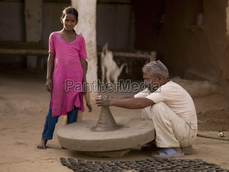 traditional pottery and young girl aravalli