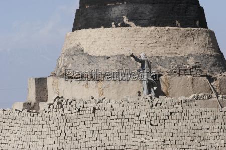 man working on a brick kiln