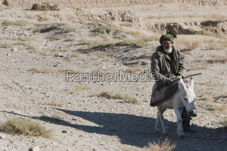 old afghan man on a donkey