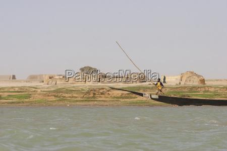 man sailing boat along the shores