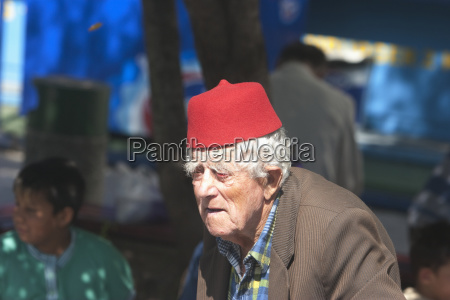 old man wearing a fez hat