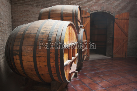 barrels in the historic cellar of