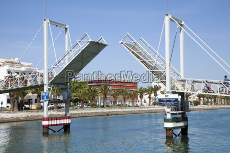 a bridge lifted for boat traffic