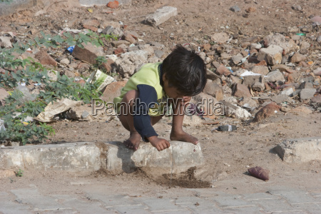 boy playing by street samode rajasthan