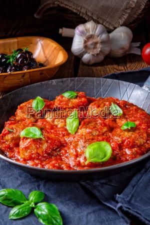 rustic mini meatballs baked in tomato