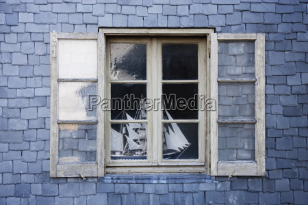 sailing ship model in a window
