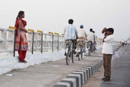 man photographing his wife on the