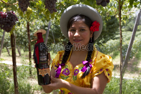 chapaca holding a bottle of red