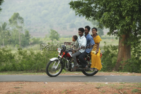 a family on a motorcycle riding