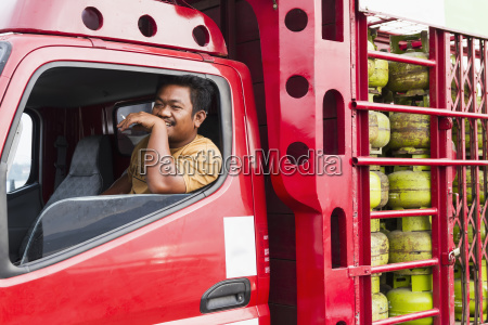 truck driver smoking a cigarette in