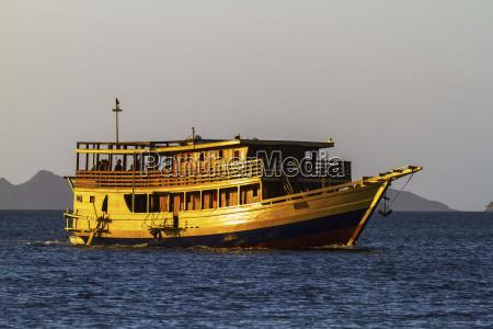 passenger boat in kima bay by