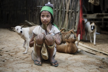 young girl sitting with dogs mae