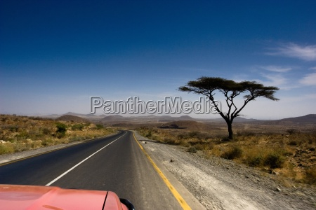 car travelling along straight road ethiopia