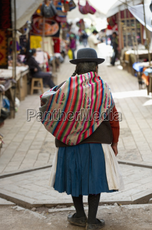 a woman in the market carrying
