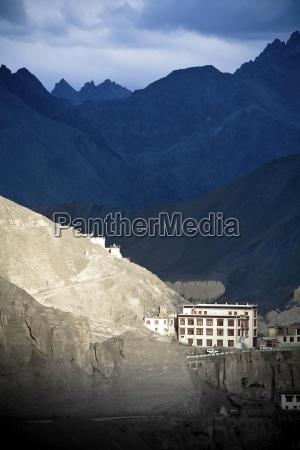 monastery sitting amid mountain range lamayuru