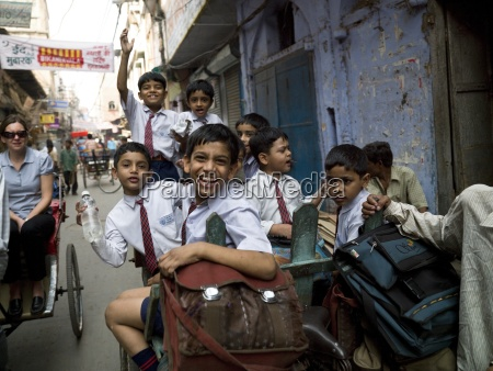 schooboys riding on a rickshaw delhi