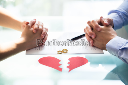 couples hand on divorce paper