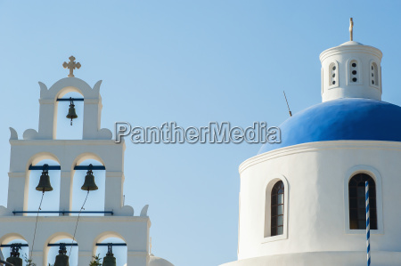 church domed roof and bells oia