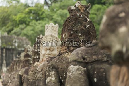 south gate of angkor connecting bayon