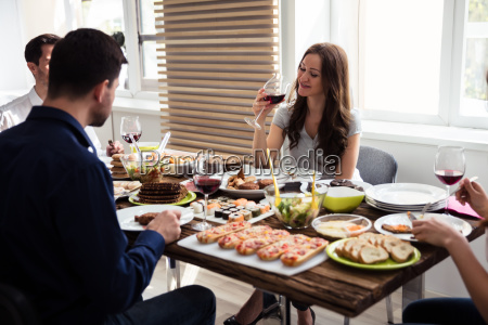 group of friends enjoying meal