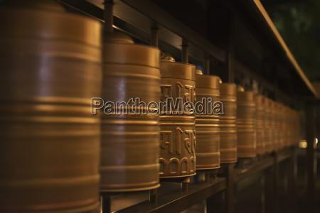 row of spinning prayer wheels at