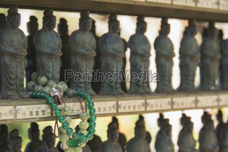 buddhist bracelet wrapped around a temple