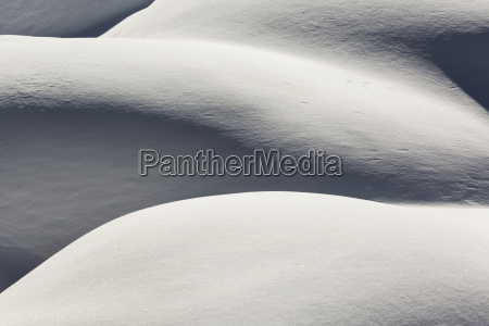 fresh snow covered mounds with light
