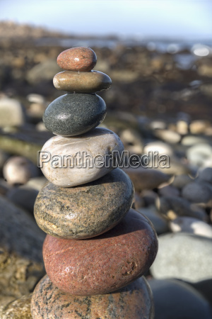 stack of rocks on the shoreline