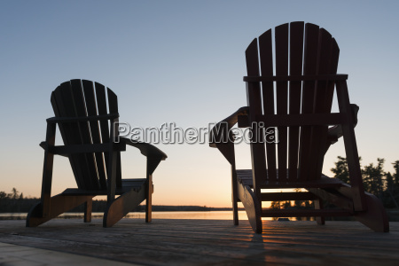 silhouette of adirondack chairs on a