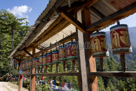 prayer wheels and prayer flags along