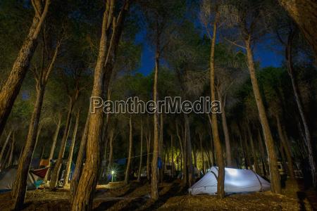 a tent illuminated at dusk at